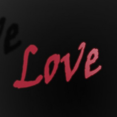 The word love in red on an infinite, black background.