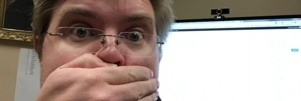 A silly selfie of Jonathan covering his mouth